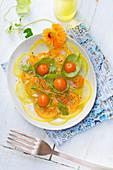 Tomato carpaccio with basil