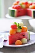Slice Of Watermelon Cake-Style Topped With Melon Balls