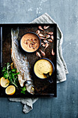 Bass a la plancha,lemon white butter sauce and brown shrimp cream with pepper