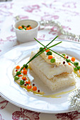 Fillet of cod with citrus fruit sabayon,vegetable pearls with truffle oil and rice