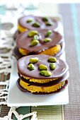 Chocolate,orange and pistachio mini layers