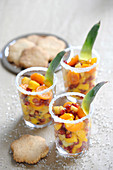 Spicy exotic fruit salads with rum and shortbread biscuits