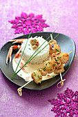 Langoustine and scallop brochettes with Cognac sauce,plain rice timbale