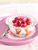 Raspberries with yoghurt,finger biscuits and hazelnuts