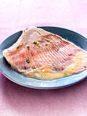 Skate cooked in a casserole with coriander and shallots