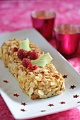 Almond and red fruit log cake