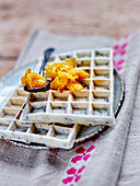 Black sesame sticky rice waffles with caramelized oranges