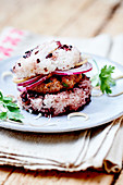 Black and white sticky rice veal and coriander burger