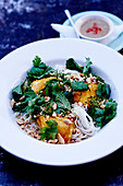 Rice vermicellis with fried fish,peanuts and fresh herbs