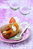 Rum baba with whipped cream,confit orange and strawberries