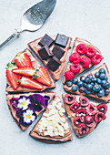 Slices of chocolate,fruit and flower brownies