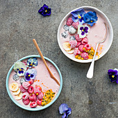 Raspberry and flower pink smoothie bowls