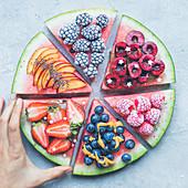 Sliced summer fruit watermelon-pizza