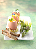 Soft-boiled eggs,roasted asparagus,Hollandaise sauce in an eggshell and Chive Fromage blanc sauce