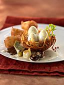 Boiled quail's eggs in a potato nest