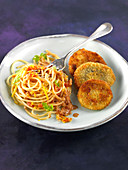 Italian-style mushroom Escalopines, spaghettis in crushed tomato and lemon and orange zests