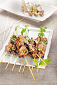 Mini pork brochettes