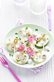 Fresh dish of cucumber,feta,olives and flowers