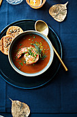 Spicy soup with a jumbo shrimp,seedy crackers