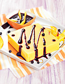 Mango square with blueberry coulis