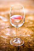 Illusion of a glass of rosé wine and water