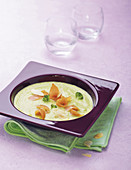 Cream of broccoli soup with almonds and salmon