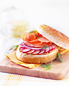 Smoked salmon marinated in lemon and dill,red onion and pink radish burger