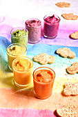 Hummus beetroot, red bean, orange lentil and spirulina, curry, carrot and pepper and cloud-shaped sesame biscuits