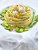 Pistachio pesto linguini nest,fresh broad beans,asparagus and quail's eggs