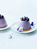 Blueberry Parfaits with pansies and sugar violets