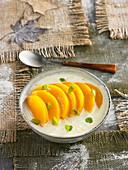 Poached peaches in orange cream