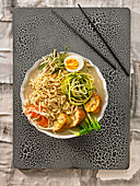 Ramen broth with vegetables,eggs and chicken Ballotine with apple