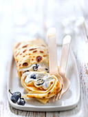 Blintzes,rolled pancakes garnished with fromage blanc and blueberries