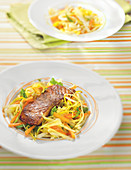 Salmon marinated in chicory, julienne of vegetables with spices