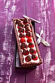 Rectangular chocolate, cottage cheese and coated strawberries tart