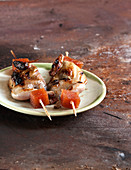 Sweet and sour quail and quince cube brochettes