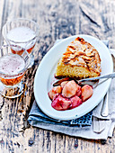 Soft almond cake with wild peaches stewed with balsamic vinegar and rosemary