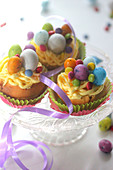 Easter nest-style cupcakes,Biscuit de Savoie and vanilla-flavored butter cream topped with sugar eggs