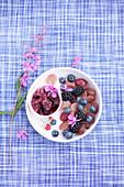Purple fruit salad and black grape granita