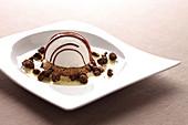 White chocolate ice cream dome on cookie and custard