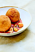Arancini And Pan-Fried Sea Food In Tomato Sauce With Parsley