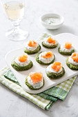 Blinis Garnished With Spinach,Cream And Smoked Salmon