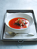 Cold red bell pepper soup with chili and green bean salad, tomato and mint