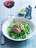 Smoked duck breast, asparagus, beans and peas in milk