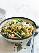 Tagliatelle with broccoli, red peppers and grated cheese