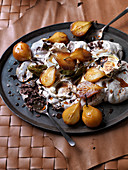 Pavlova with small pears poached with spices, maple syrup and bay leaves