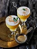 Pumpkin, vodka, maple syrup, cinnamon and nutmeg cocktail