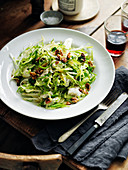 Shredded Brussels sprouts, walnuts and gorgonzola salad