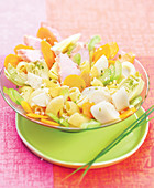 Pasta salad with chicken, hard-boiled egg, carrots, hearts of palm and artichoke hearts