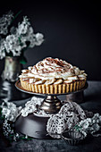 Banoffee Pie With A Biscuit Crust, Nutella Mousse, Bananas And Cream